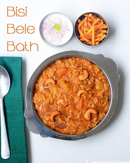 bisi bele bath serve with onion raita, potato chips