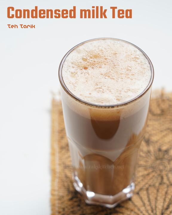 Teh tarik served in a glass tumbler