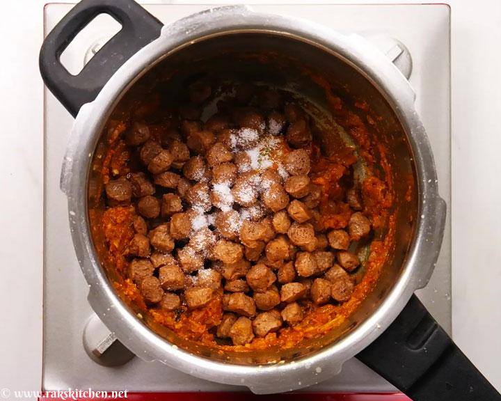 add salt, cooked soya chunks